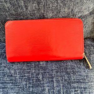 Louis Vuitton epi zip around red wallet